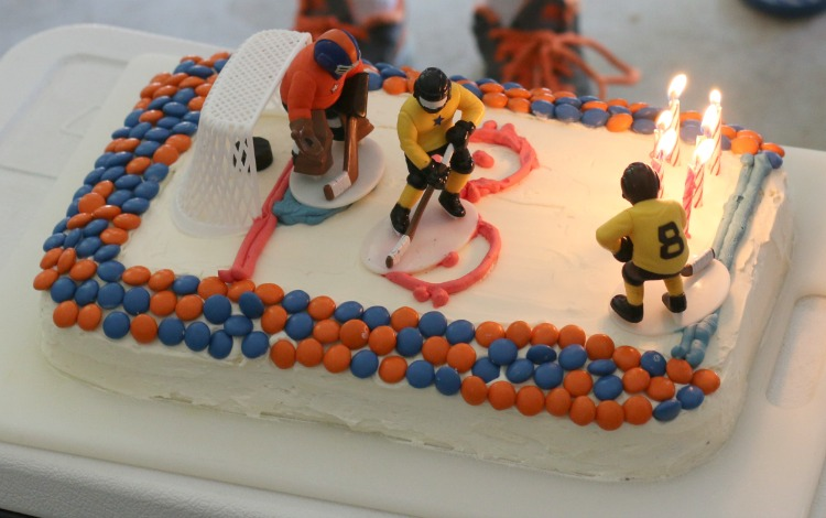 Invite your kids to join you in the kitchen to bake their own sports-themed birthday cake. It's easier than you think.